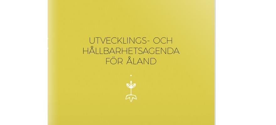 Gröngul bakgrund med texten Utvecklings- och hållbarhetsagenda för Åland. Agendans pärm.
